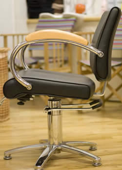 Photograph of a stylists chair at Backstage Hair Cutters